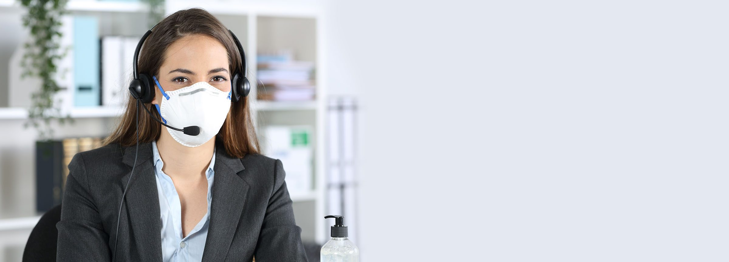 Woman with mask and headset