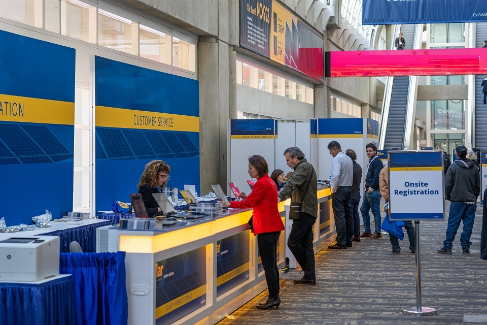 Event kiosk with people in line